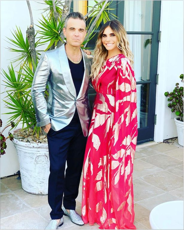Millionaire Robbie Williams and wife Ayda share their bath water because they are looking at the coins.