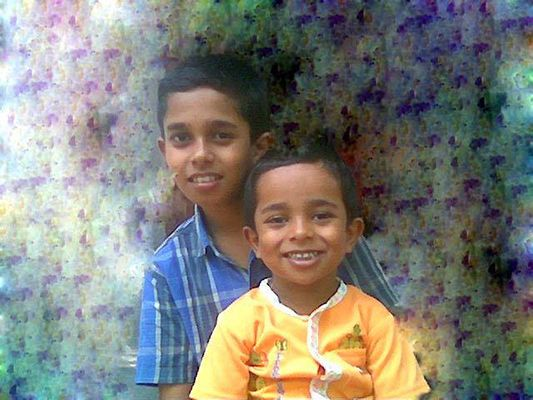 Childhood photo of Adoney John with his brother