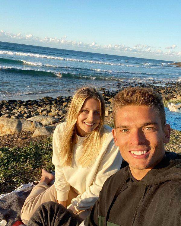 Chris Green with his girlfriend Bella Wagschall on the beach