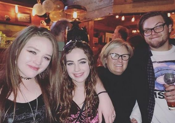 Mary Mouser with her mother and siblings