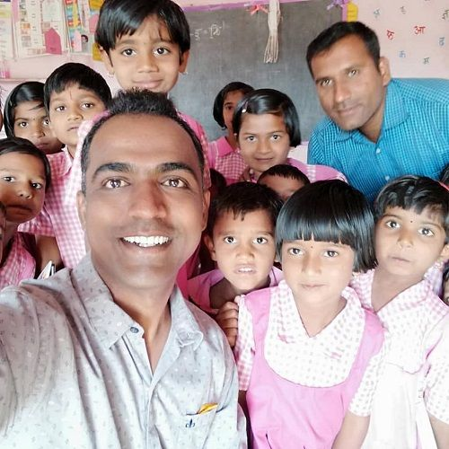 Ranjitsinh Disale with his students