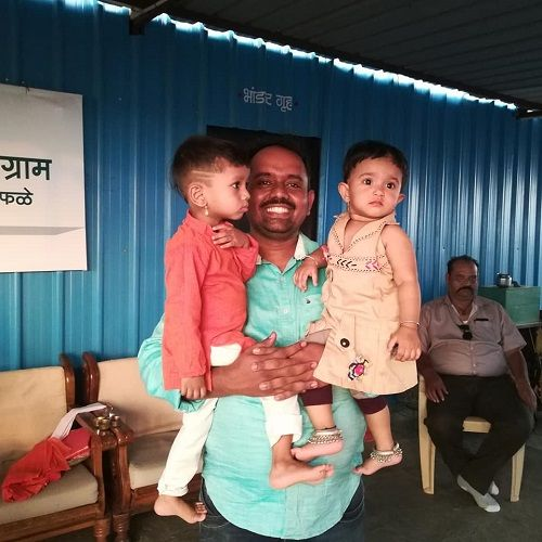 Brother with children by Ranjitsinh Disale